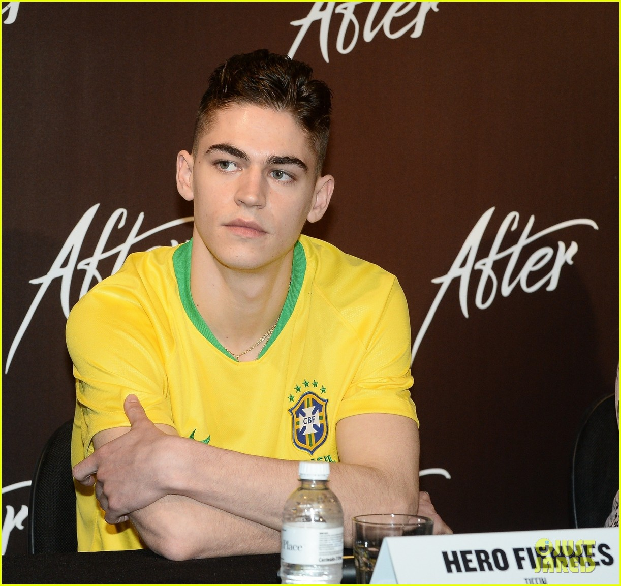 "Hero Fiennes-Tiffin listens to a question during a press event for ""After"" in Brazil."