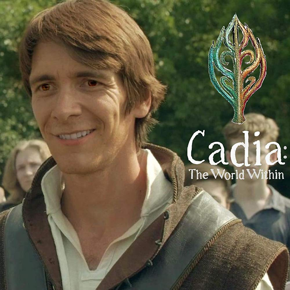 "James Phelps smiles in a film still from ""Cadia: The World Within""."