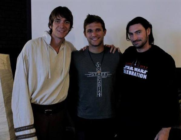 "James Phelps poses with director Cedric Gegel, center, and fellow actor John Wells on the set of ""Cadia: The World Within""."