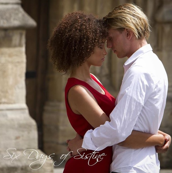"Jamie Campbell Bower and costar Elarica Johnson embrace in a film still from ""Six Days of Sistine""."