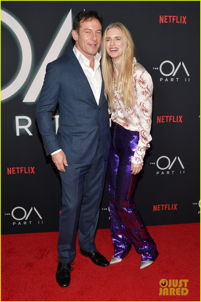 "Jason Isaacs and costar Brit Marling pose for photos on the red carpet during a premiere event for ""The OA"" in Los Angeles."