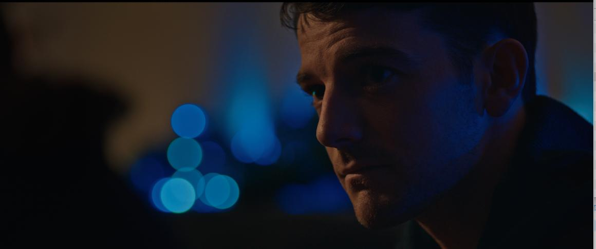 "Kevin Guthrie is seen looking pensive in a film still from ""Connect""."