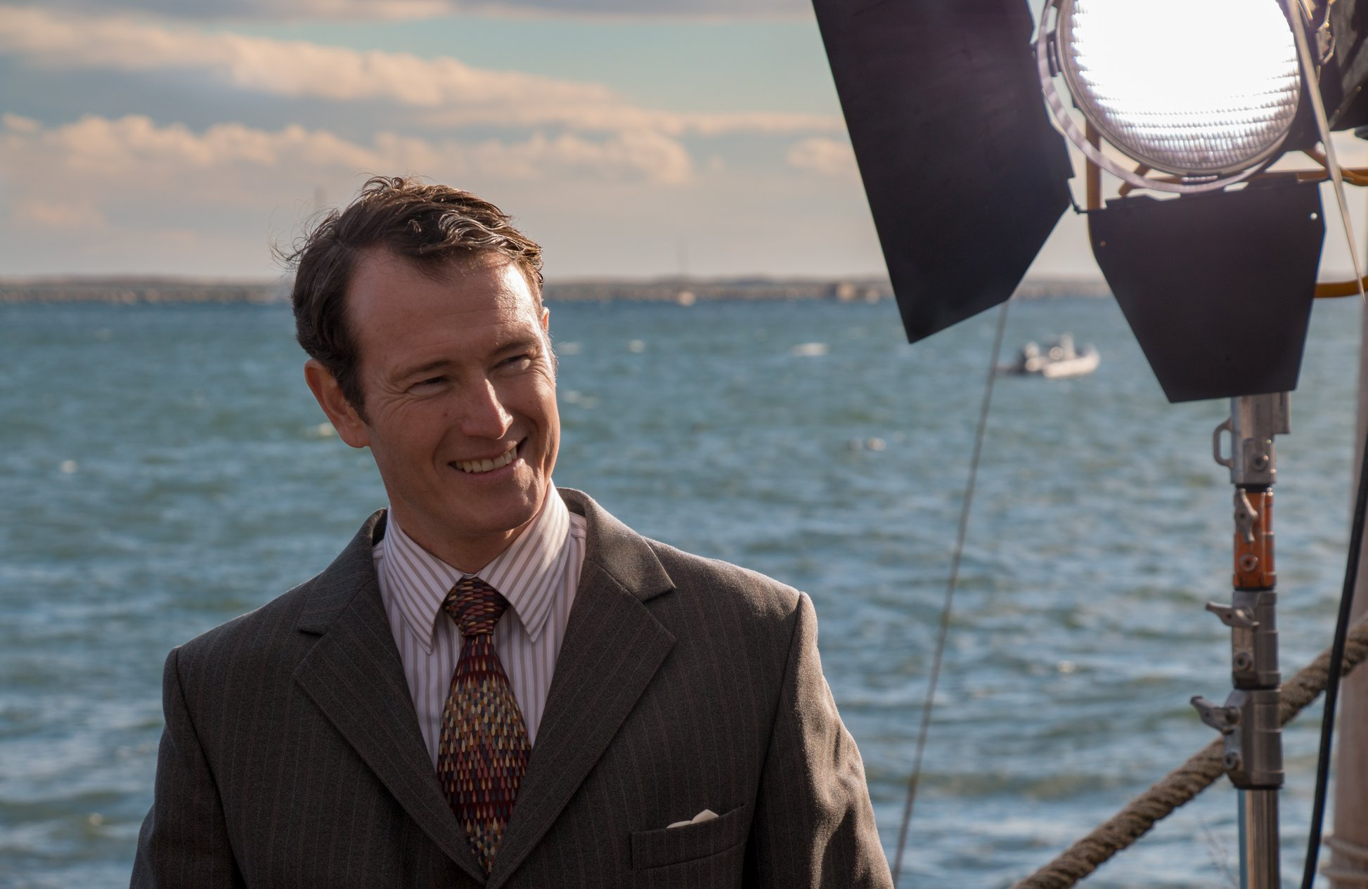 "Nick Moran smiles on the set of ""Gilpin""."