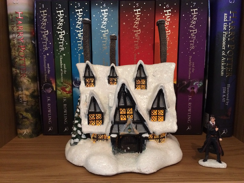 "When illuminated, the windows of the ""THREE BROOMSTICKS PUB™"" look so cozy and inviting!"