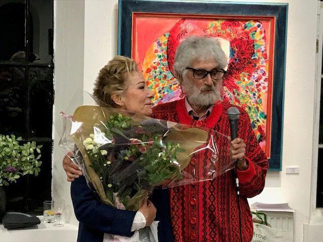 "Zoë Wanamaker hugs artist Philip Sutton during the opening of his art exhibit, ""My Shakespeare""."
