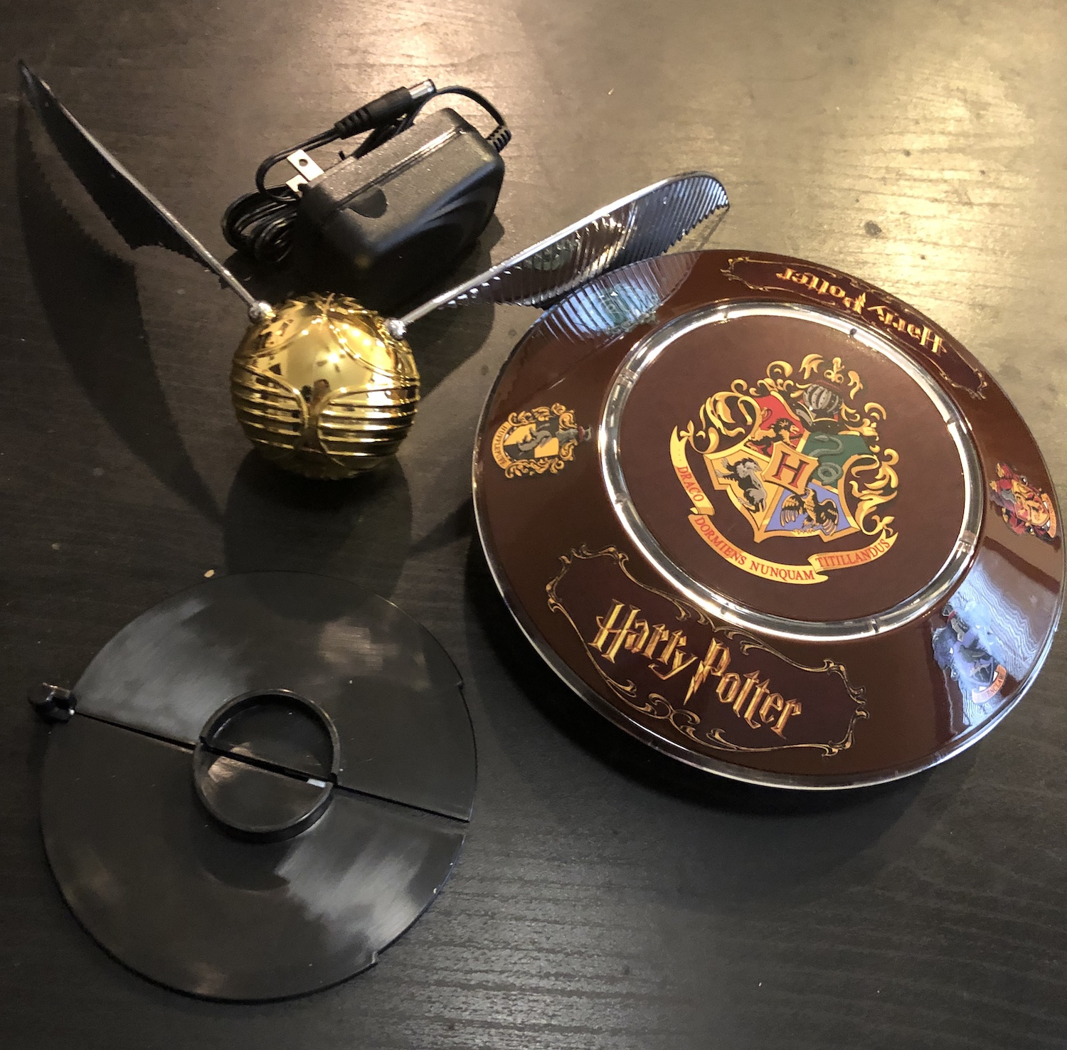 Full GOLDEN SNITCH™ set, including AC adapter, illuminated base, GOLDEN SNITCH™, and a launcher