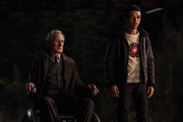 """Justice Smith stands alongside Bill Nighy in a still from """"Detective Pikachu""""."""