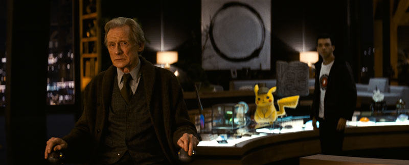 Bill Nighy is seen with Detective Pikachu and Justice Smith in the background.