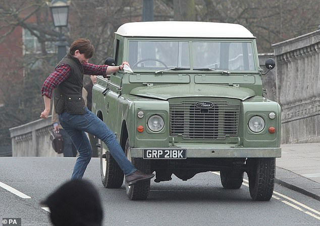 """Domhnall Gleeson takes out his frustrations on a broken-down Land Rover during filming for """"Peter Rabbit 2""""."""