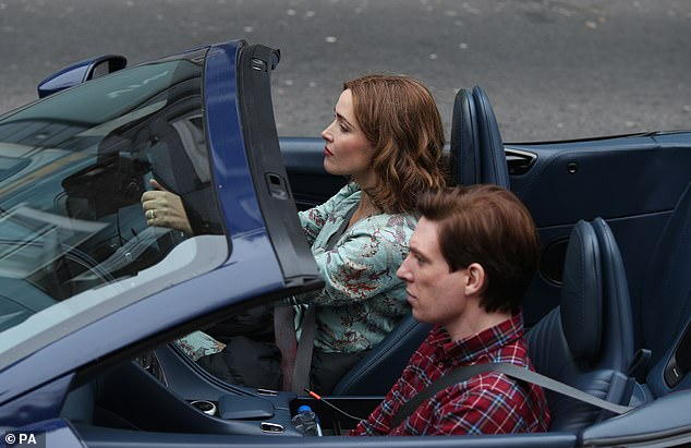 """Domhnall Gleeson takes a drive with Rose Byrne during filming for """"Peter Rabbit 2""""."""