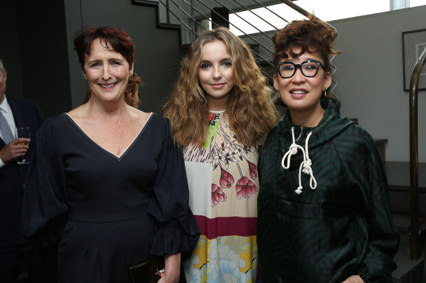 """Fiona Shaw poses with """"Killing Eve"""" costars Jodie Comer and Sandra Oh at a party for the Season 2 premiere of the show."""