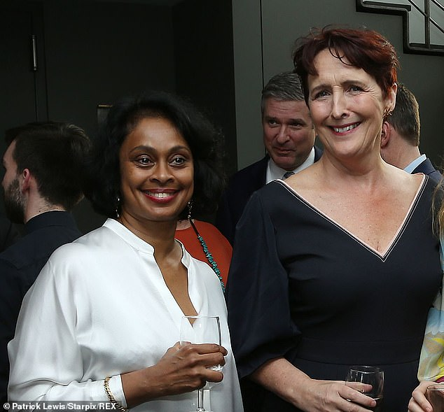 """Fiona Shaw and wife Dr. Sonali Deraniyagala pose at a party celebrating the premiere of Season 2 of """"Killing Eve"""" in New York."""