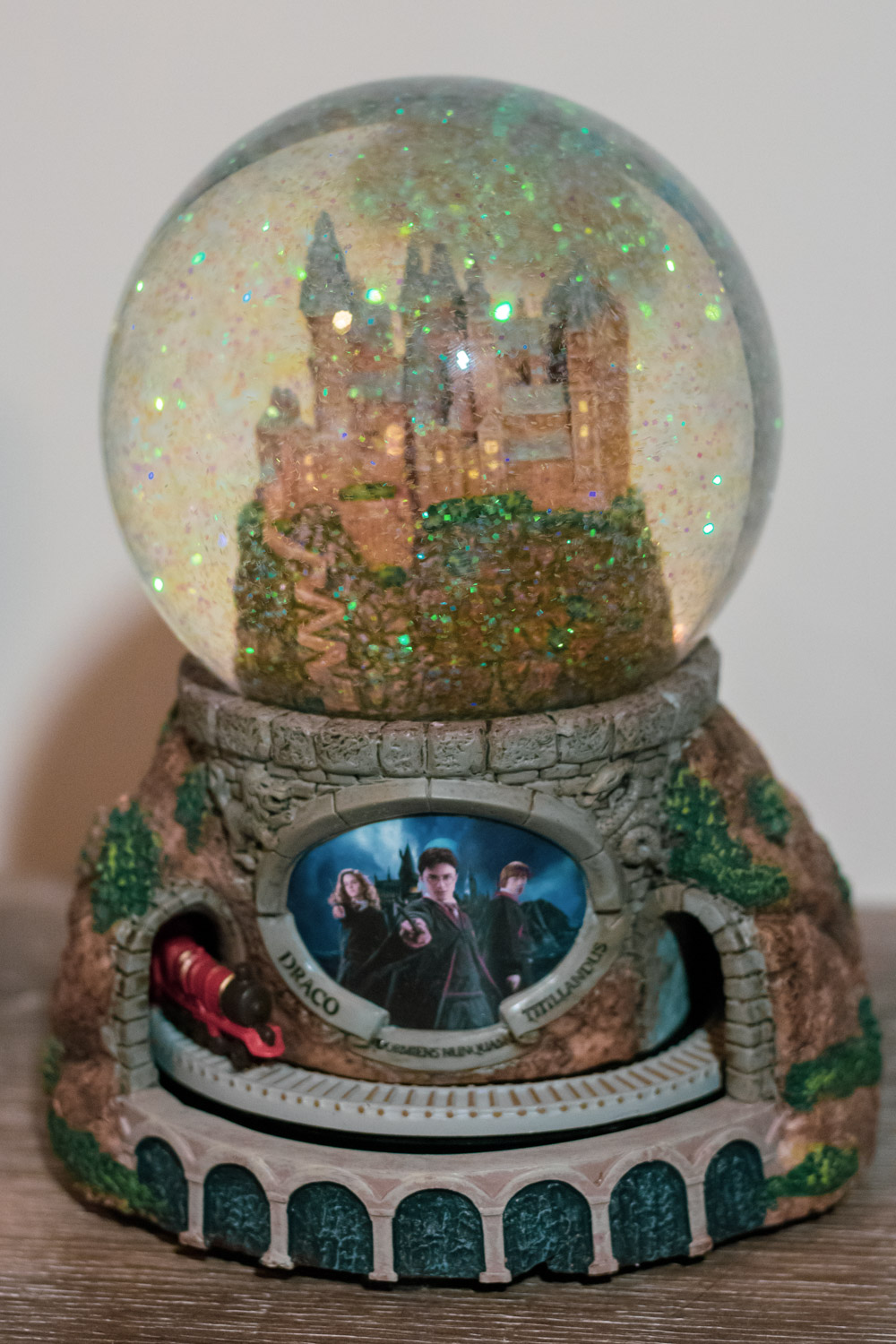 """Front view of """"HOGWARTS™ Express"""" Glitter Globe with glitter falling inside"""