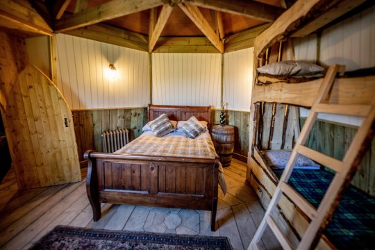 The bedroom in North Shire's groundskeeper's cottage can sleep four guests.
