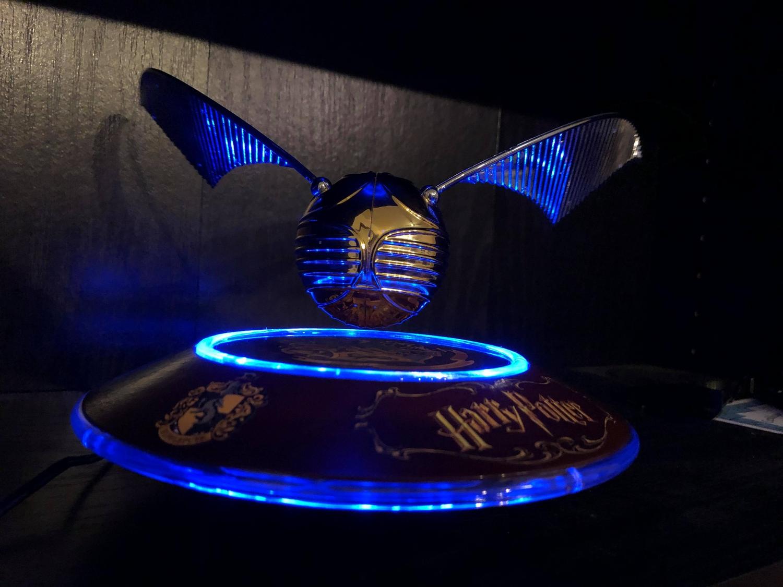 Harry Potter GOLDEN SNITCH™ on base, lit up