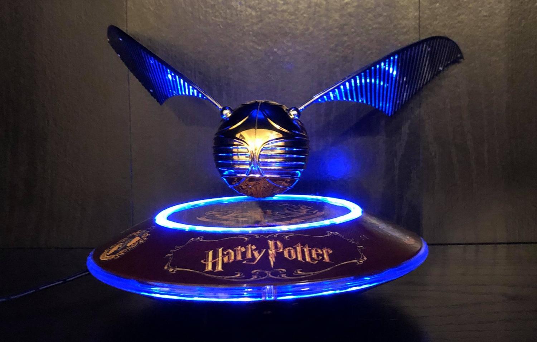 "Harry Potter GOLDEN SNITCH™ on base, showing the ""Harry Potter"" logo design"