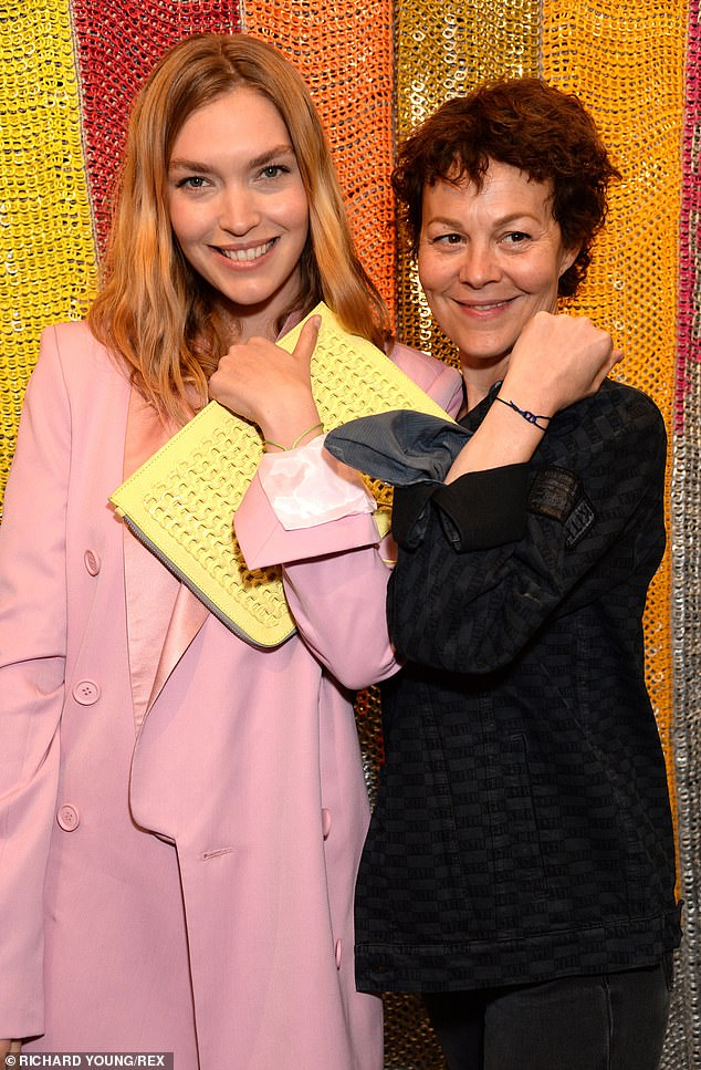 """Helen McCrory and Arizona Muse display their """"Together Bands"""" at the Bottletop campaign launch in London."""