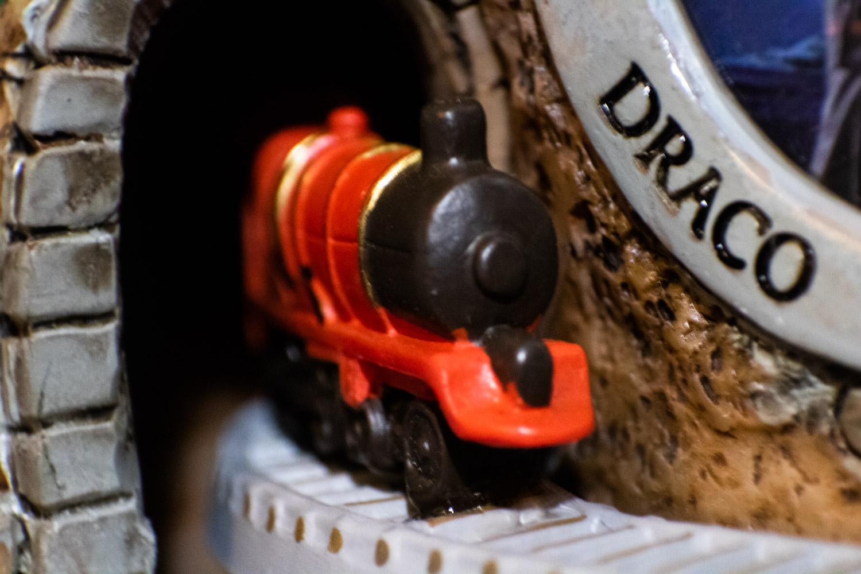"""HOGWARTS™ Express"" train close-up as it leaves the tunnel on the front of the ""HOGWARTS™ Express"" Glitter Globe"