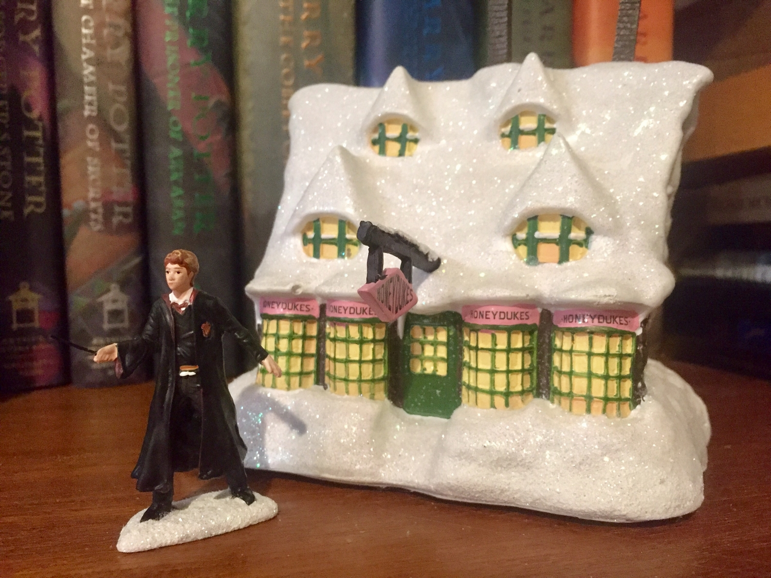 """HONEYDUKES™"" Sweet Shop and ""RON WEASLEY™"" displayed in front of the hardback ""Harry Potter"" books"