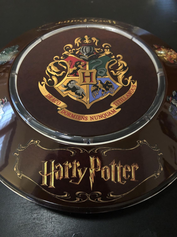 Illuminated base featuring the Hogwarts crest