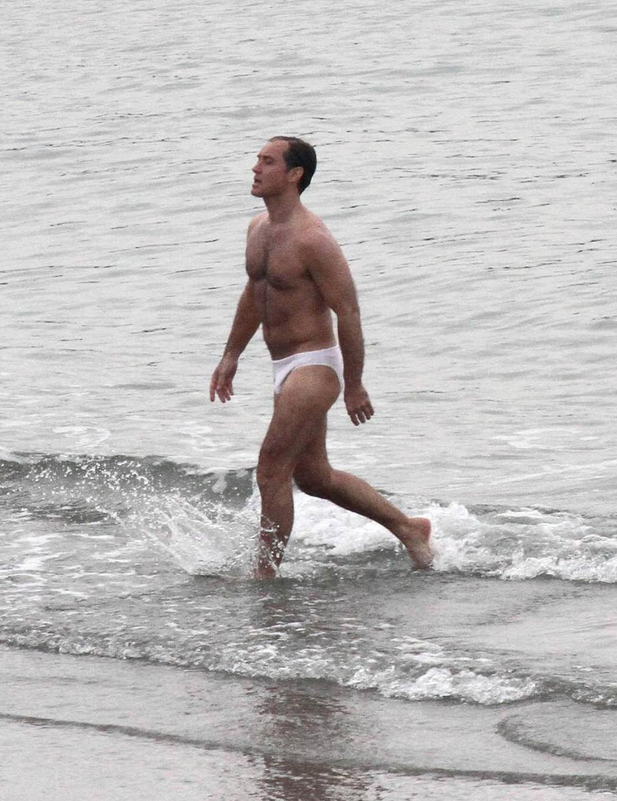 """Jude Law makes his way onto the beach during filming for """"The New Pope"""" in Venice."""