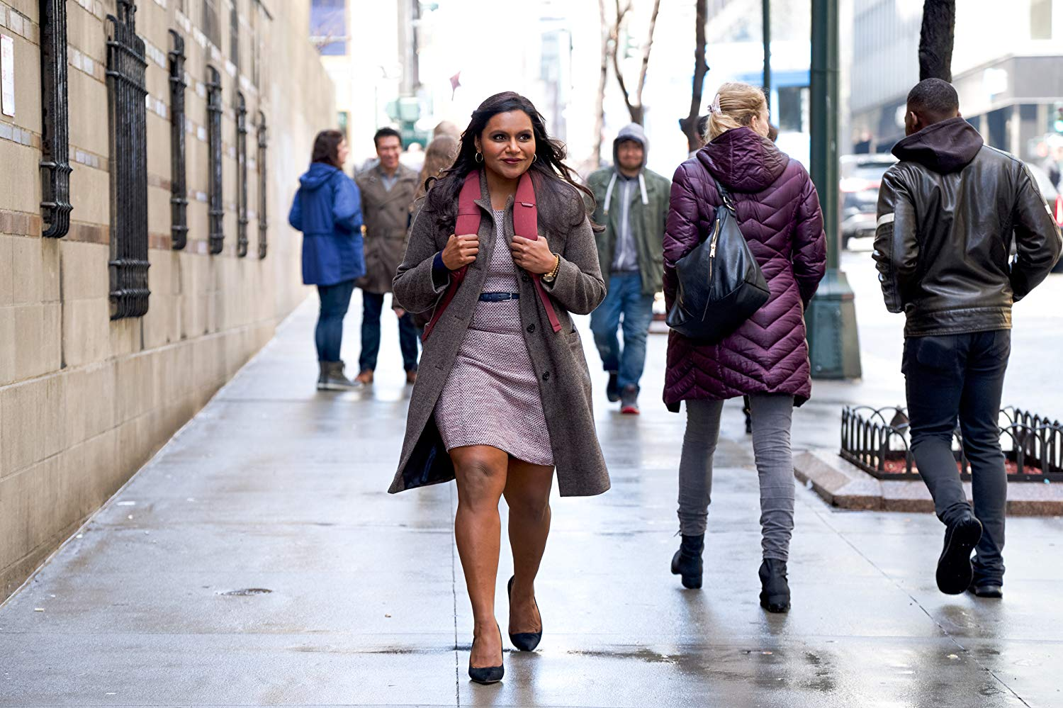 "Mindy Kaling walks down the street with purpose in this still from ""Late Night""."