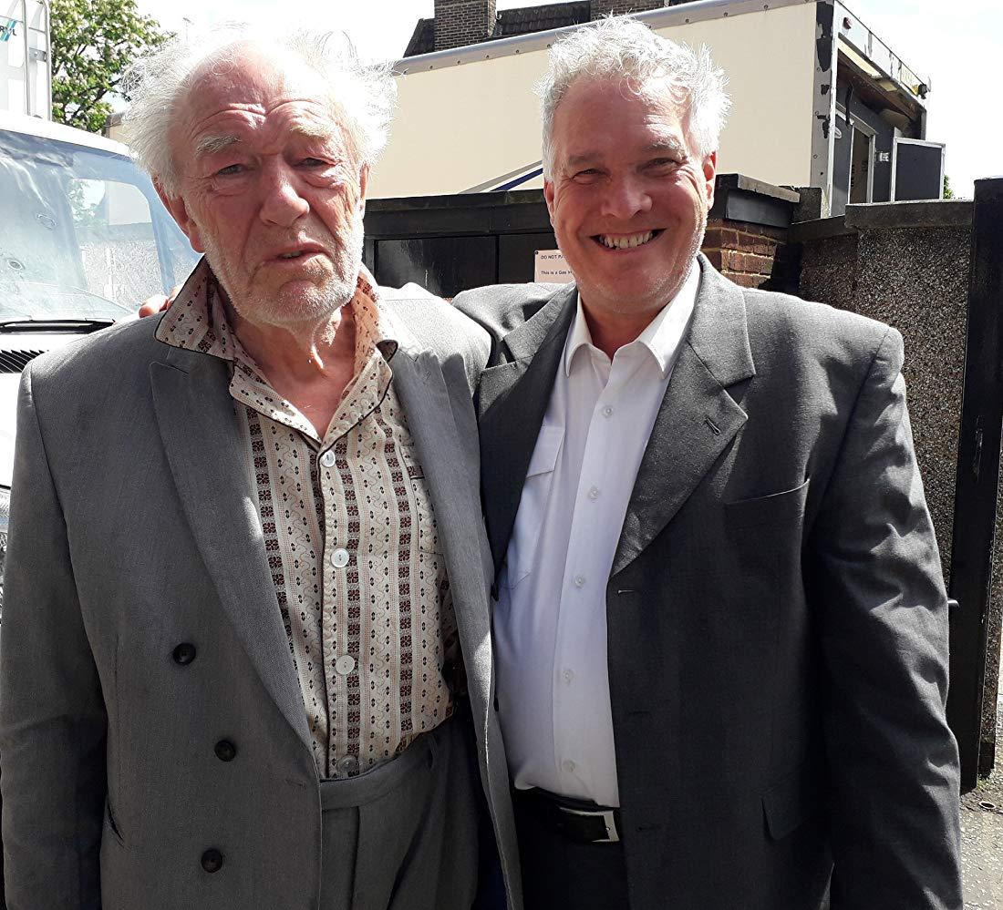 """Sir Michael Gambon poses with Chris Wilson on the set of """"Cordelia""""."""