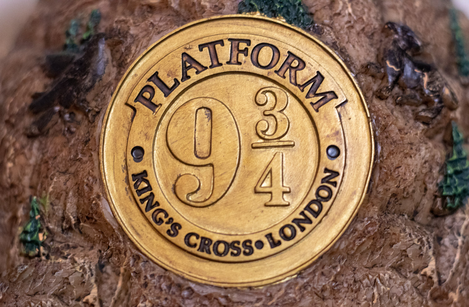 "Platform 9 3/4 crest on the back of the ""HOGWARTS™ Express"" Glitter Globe"