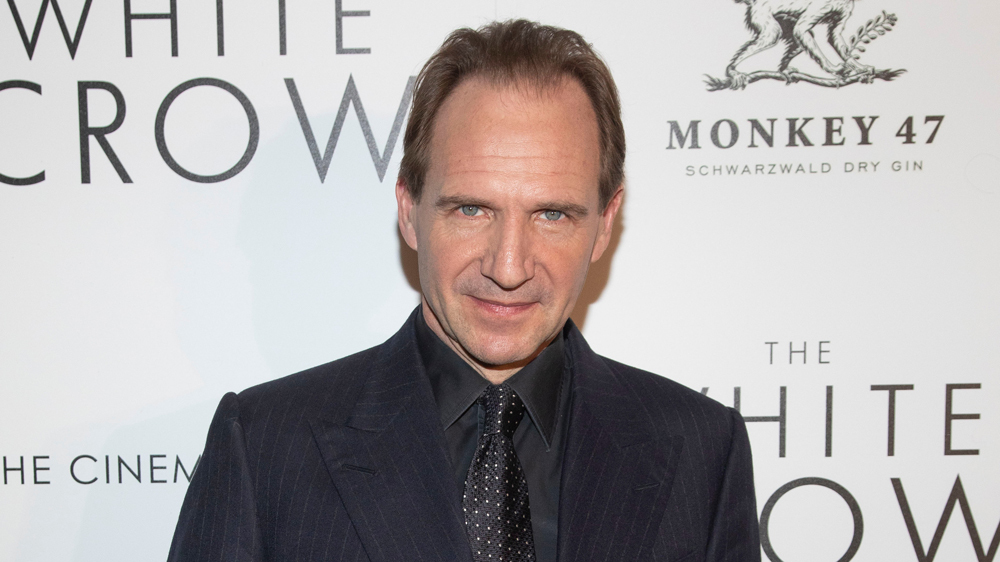 """Ralph FIennes poses for the camera during a screening of """"The White Crow"""" in New York."""