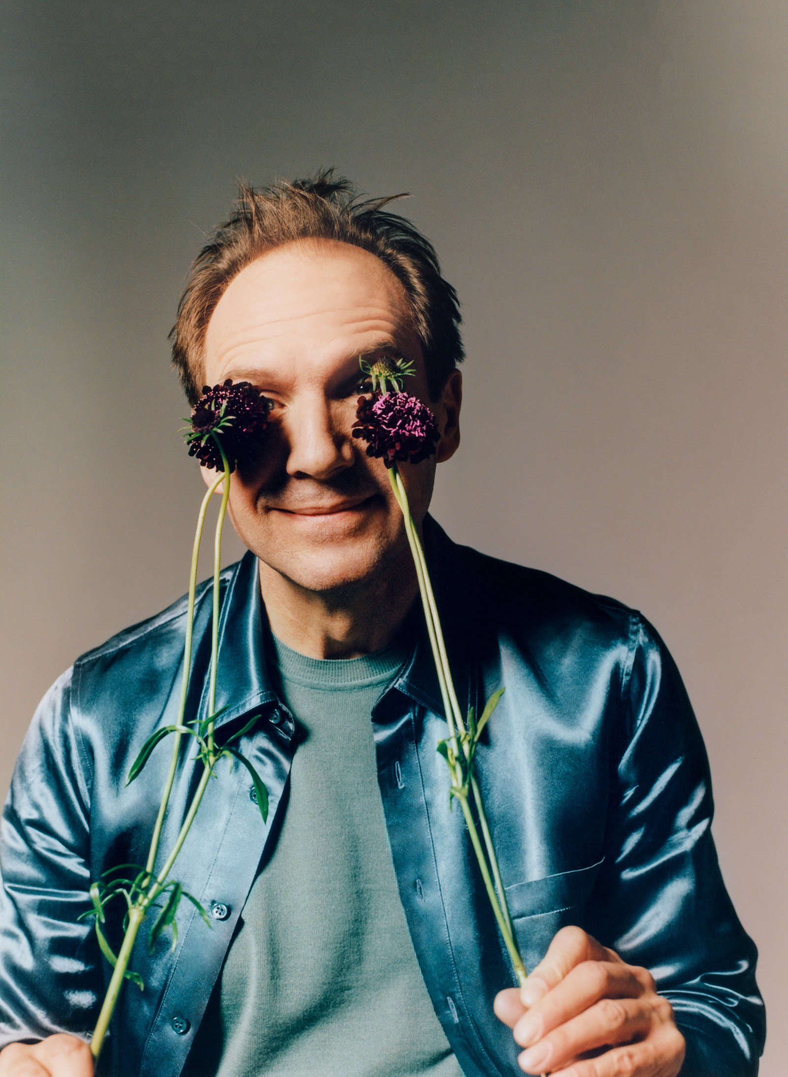 """Ralph Fiennes tries to see the rosy side of life in a photo shoot for """"GQ""""."""