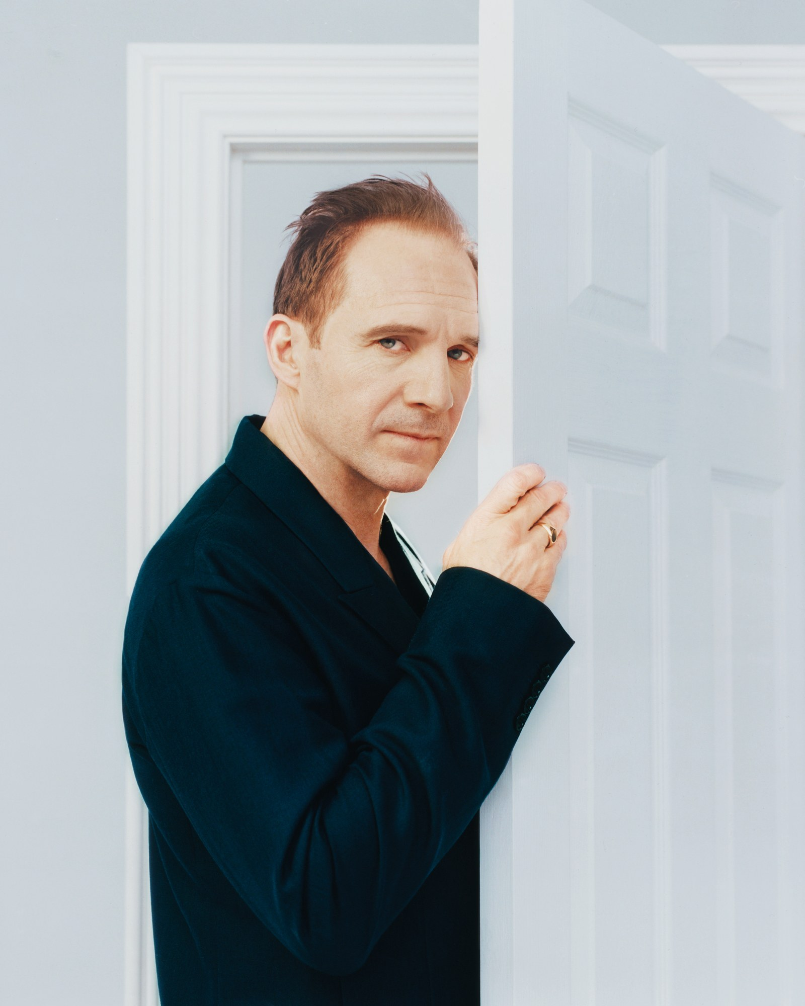 """Knock knock! Who's there? It's Ralph Fiennes, during a photo shoot for """"GQ""""."""
