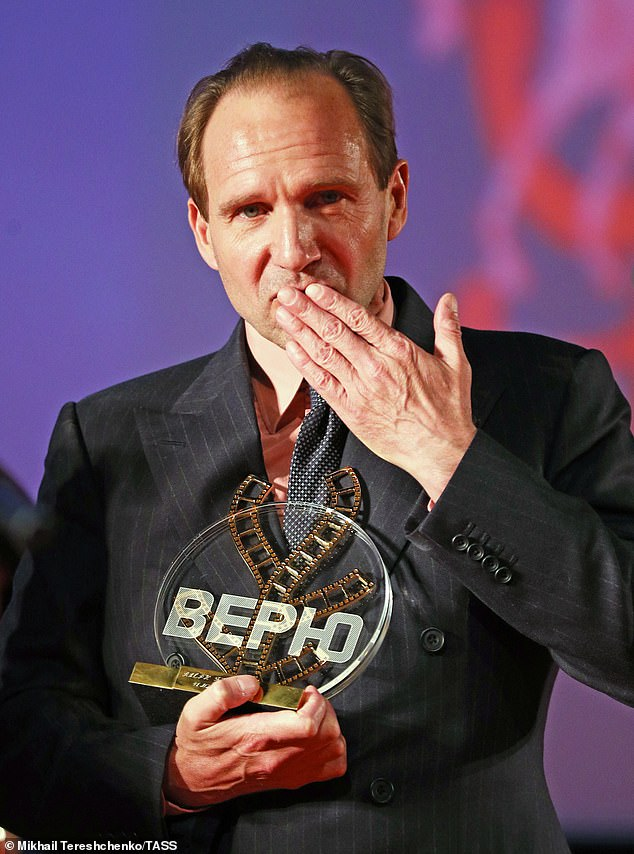Ralph Fiennes blows a kiss to the crowd after receiving the Konstantin Stanislavski Award in Moscow.