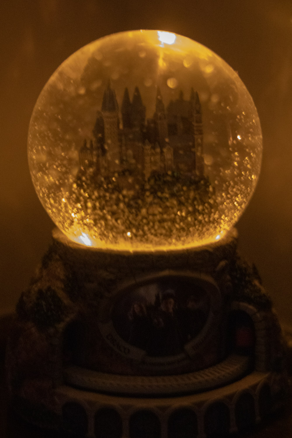 "Full front picture of the ""HOGWARTS™ Express"" Glitter Globe with lights on"