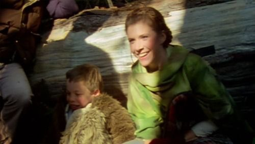 Warwick Davis takes a break from filming as Wicket the Ewok alongside Carrie Fisher.