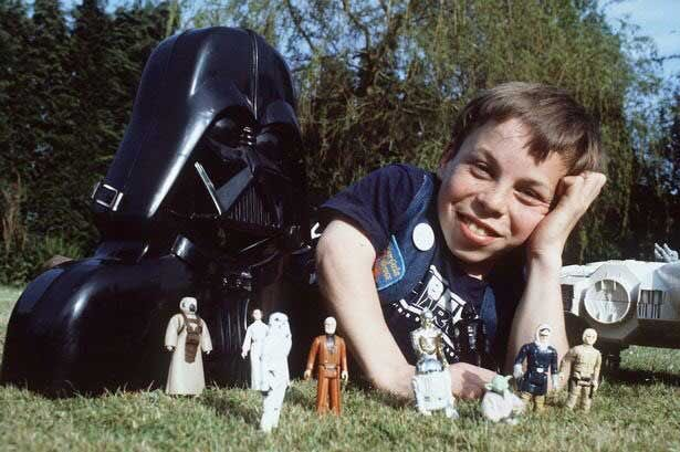 """Warwick Davis poses with some of his coveted """"Star Wars"""" collectibles."""