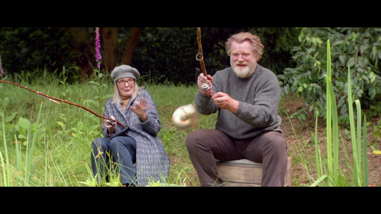 "Brendan Gleeson schools Diane Keaton in the art of fishing in ""Hampstead""."