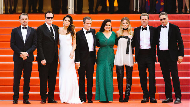 David Heyman poses for a photo at Cannes with Leonardo DiCaprio, Quentin Tarantino, Daniela Pick, Shannon McIntosh, Margot Robbie, Brad Pitt, and Thomas Rothman.