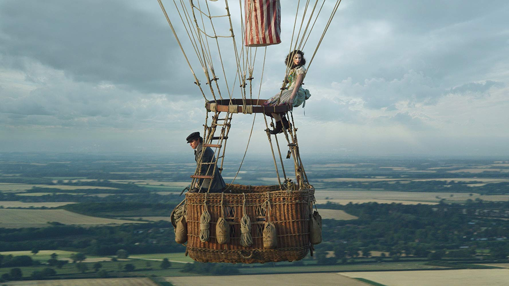 """Eddie Redmayne and Felicity Jones go up, up and away in this still from """"The Aeronauts""""."""