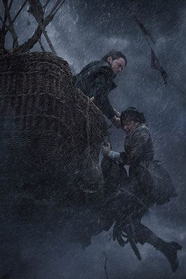 """Eddie Redmayne battles to pull Felicity Jones back into the hot air balloon amidst a storm during this still from """"The Aeronauts""""."""