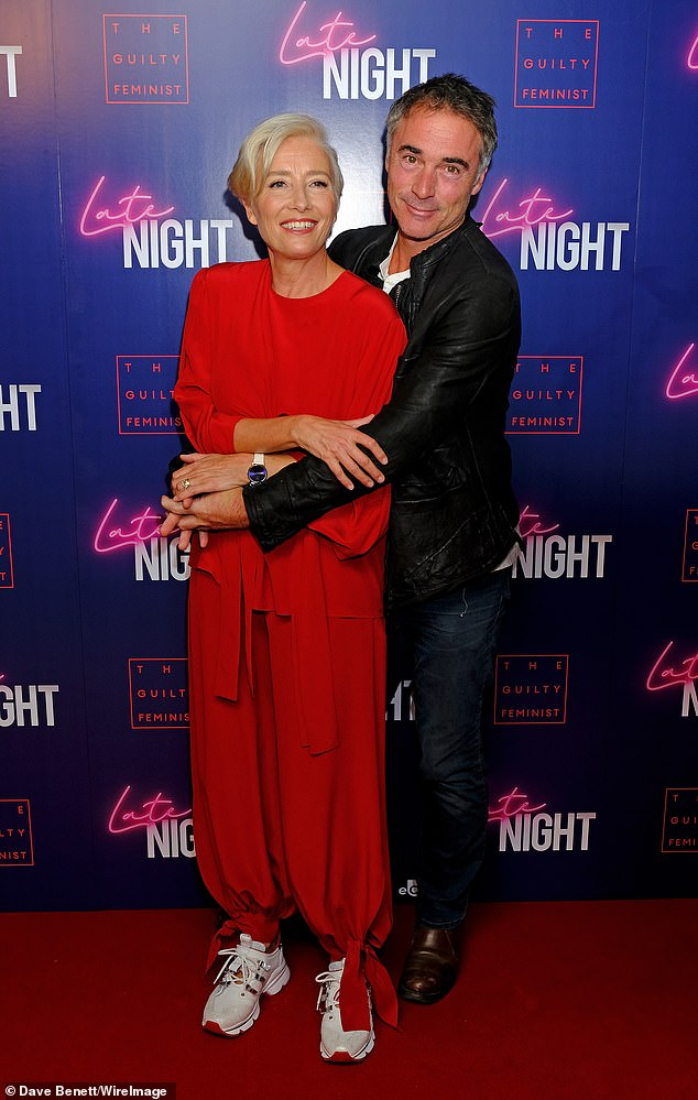 "Emma Thompson smiles alongside husband Greg Wise at a London screening of ""Late Night""."