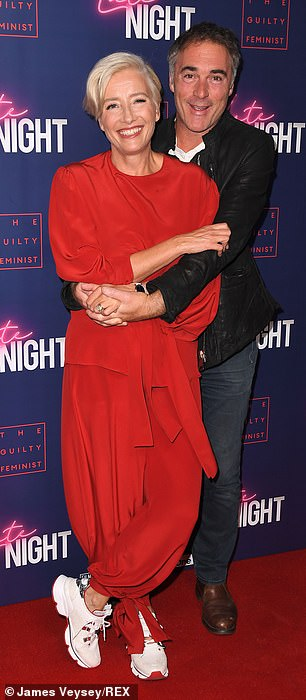 "Emma Thompson shares a cuddle with husband Greg Wise at a London screening of ""Late Night""."