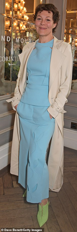 Helen McCrory looks smart in an aquamarine two-piece and lime-green heels at the Roland Mouret luncheon in London.