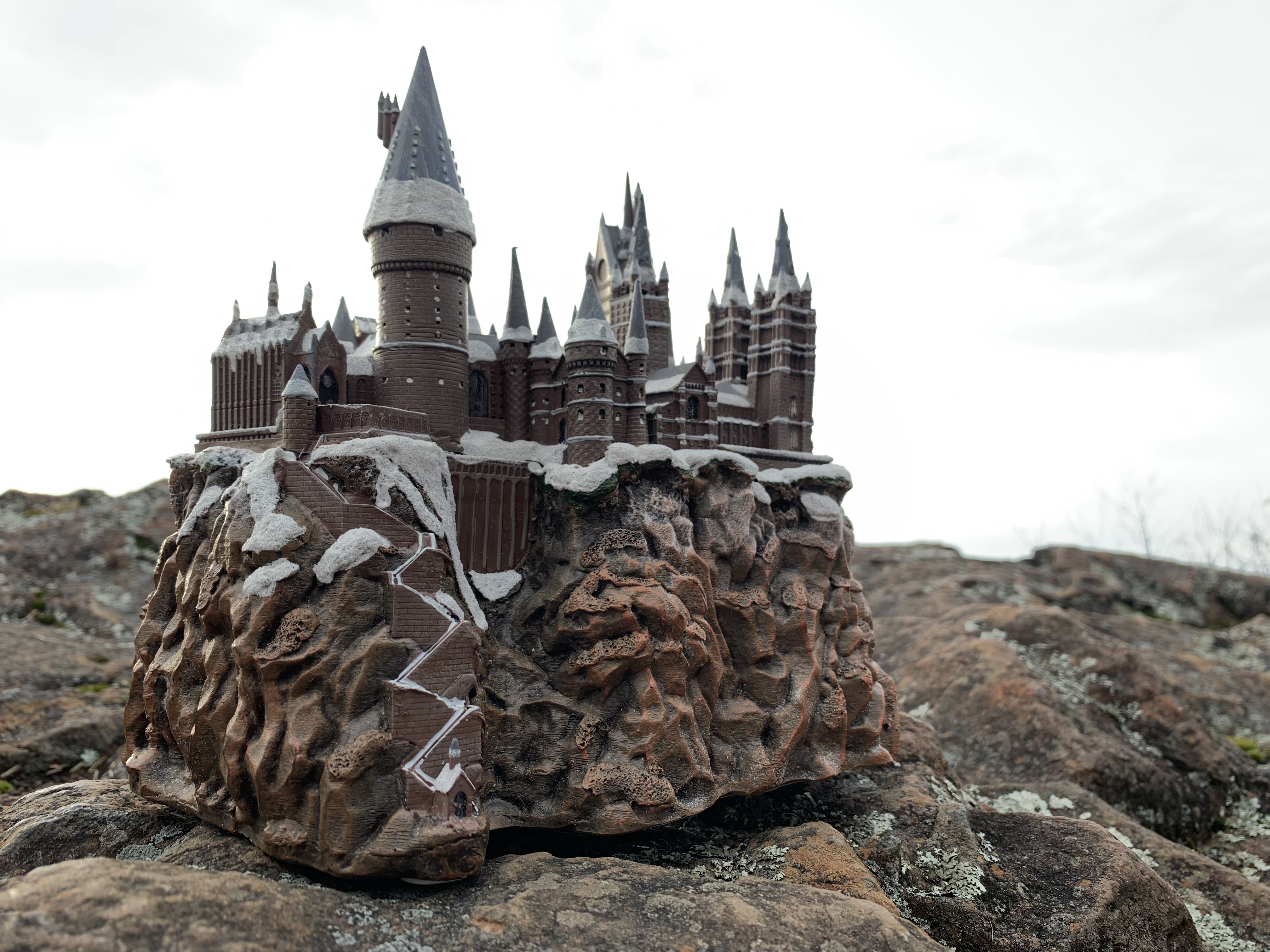 """HOGWARTS™"" School of Witchcraft and Wizardry from The Bradford Exchange, full side view of the castle and boathouse"