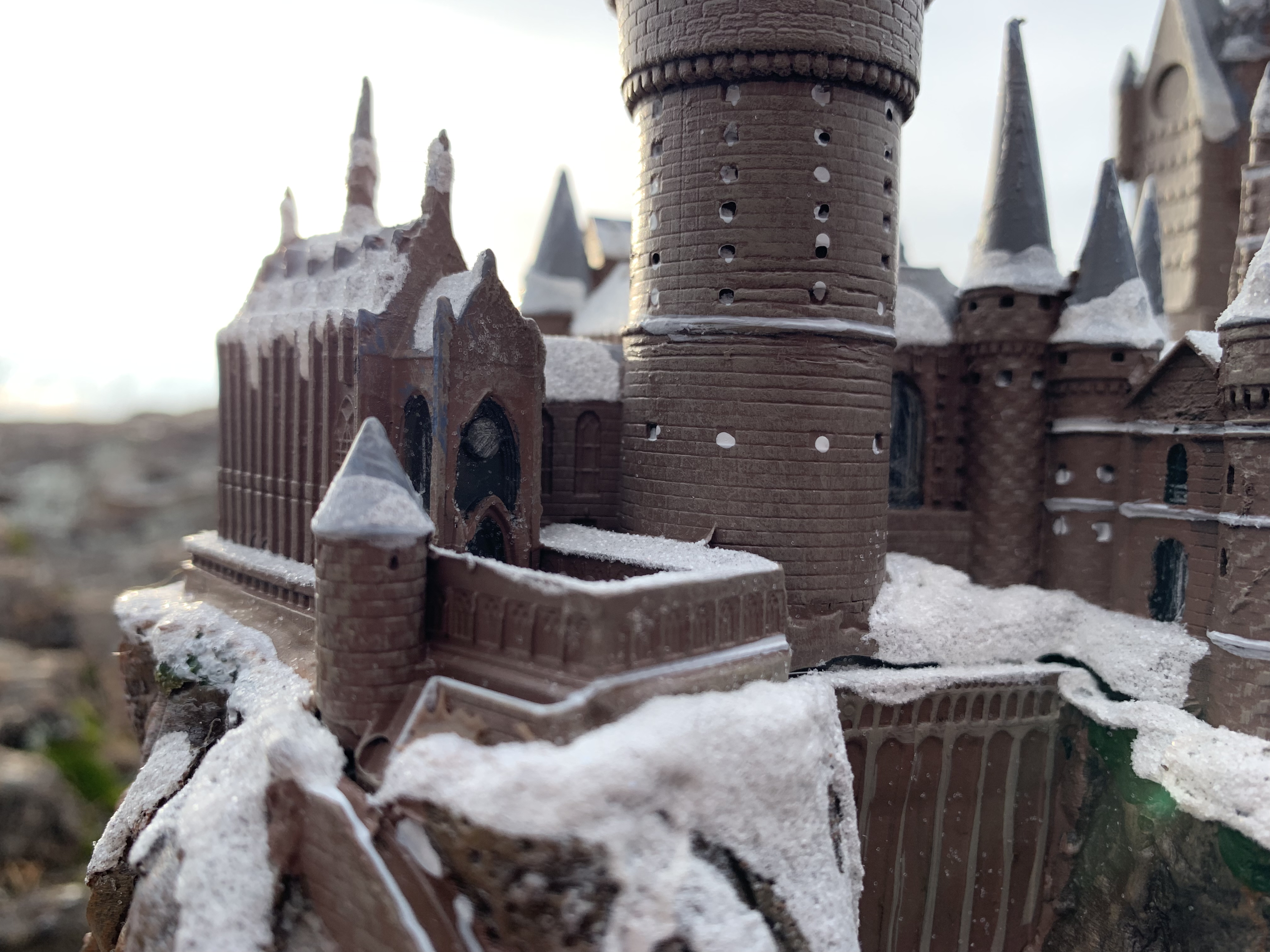 """""""HOGWARTS™"""" School of Witchcraft and Wizardry from The Bradford Exchange, side view of the clock tower and courtyard leading to the stairs and boathouse"""
