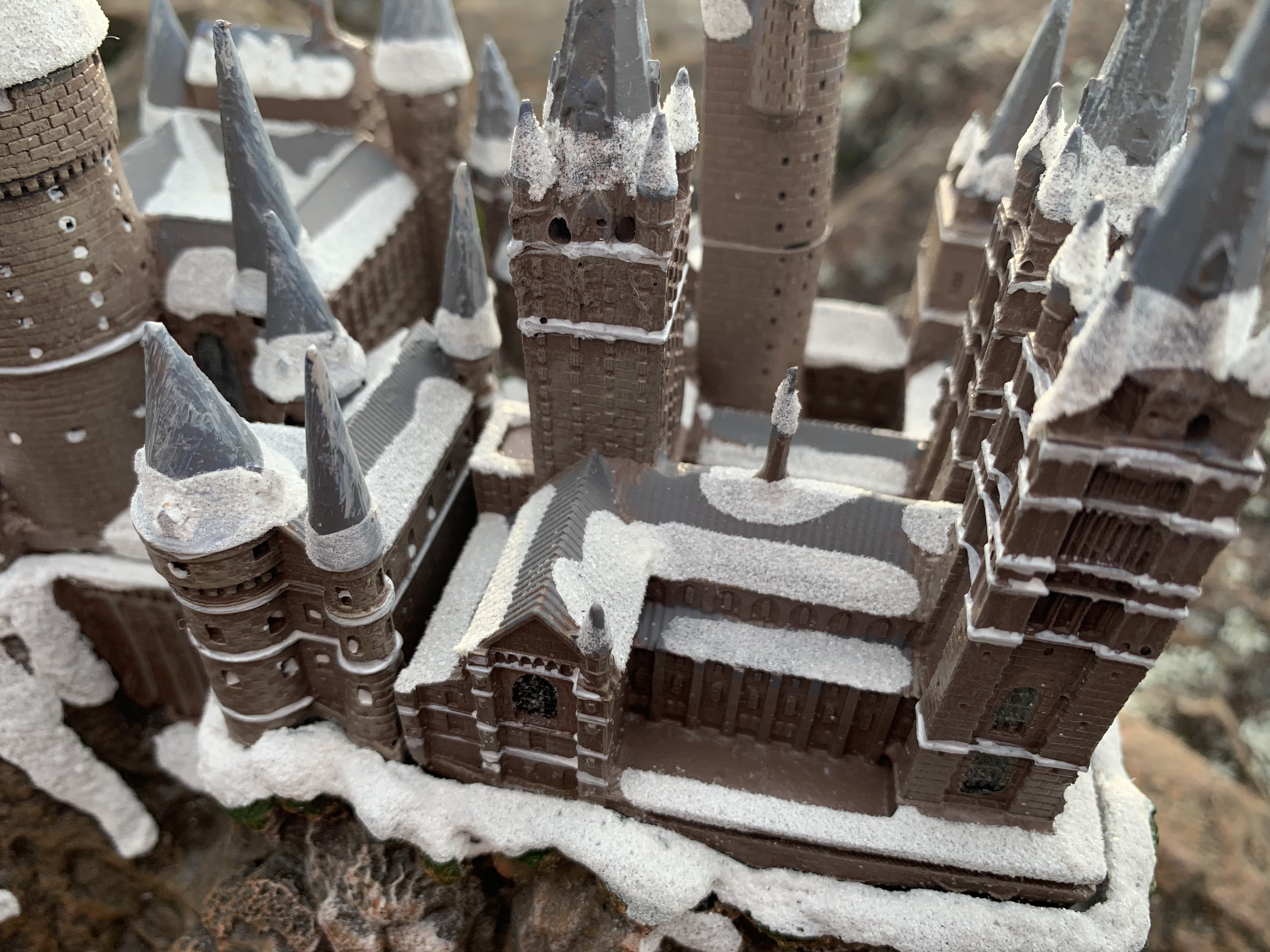 """HOGWARTS™"" School of Witchcraft and Wizardry from The Bradford Exchange, view from the top showing the snow-covered roof of the Great Hall and surrounding towers and turrets"