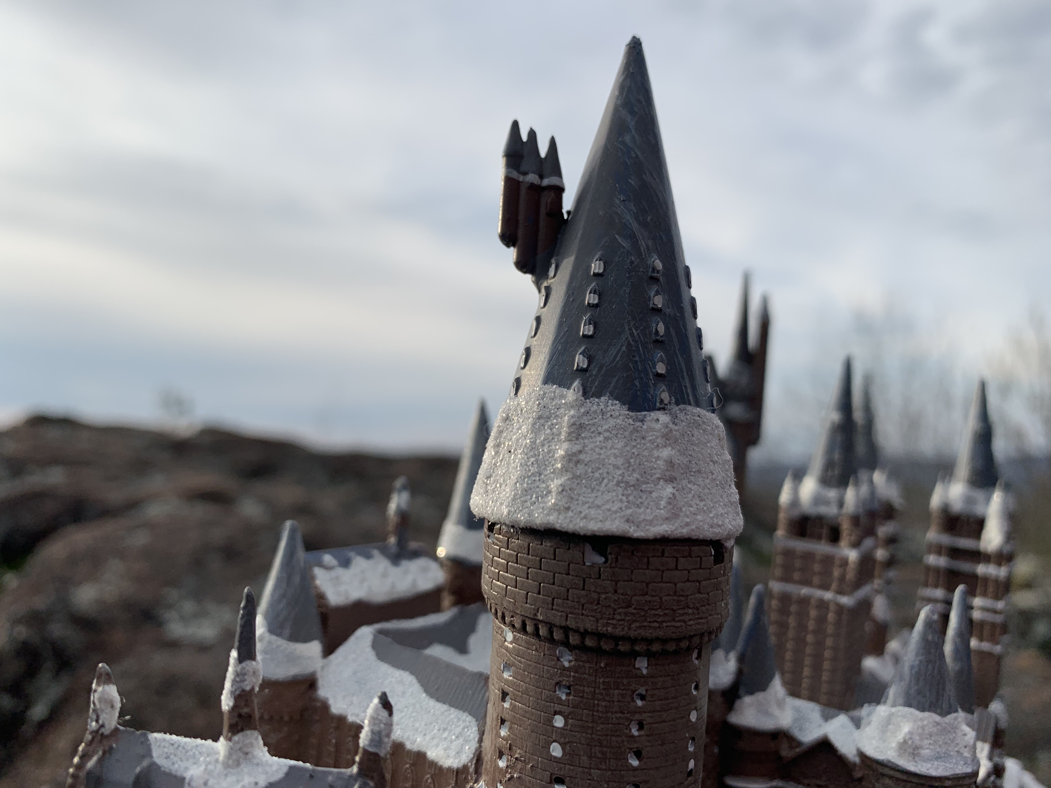 """""""HOGWARTS™"""" School of Witchcraft and Wizardry from The Bradford Exchange, detailed view of the snow-covered tower"""