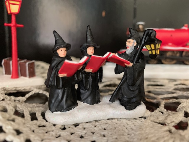 "Hogwarts carolers at the ""HOGWARTS EXPRESS™"" from The Bradford Exchange Harry Potter Illuminated Village collection"