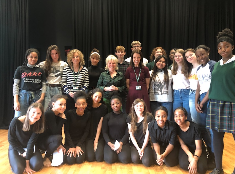Imelda Staunton poses for a photo with students at her former school.