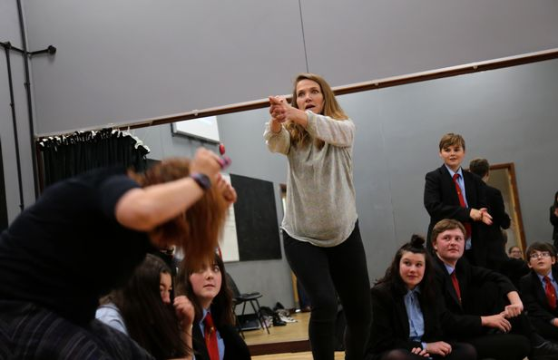 Jessica Hynes acts out a scene with students.