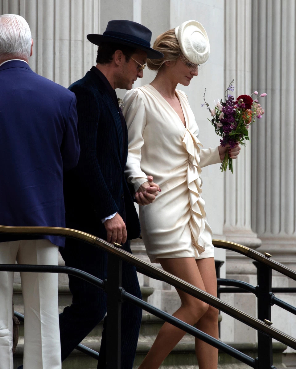 Jude Law and new wife Phillipa Coan emerge from a Central London courthouse after marrying in a civil ceremony.